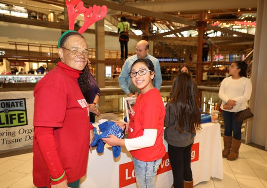 Heart recipients Roxanne Watson from Nanuet, at left, and Bella Munoz, 13, from Tomkins Cove, at the Palisades Center in West Nyack to educate people about organ donations.