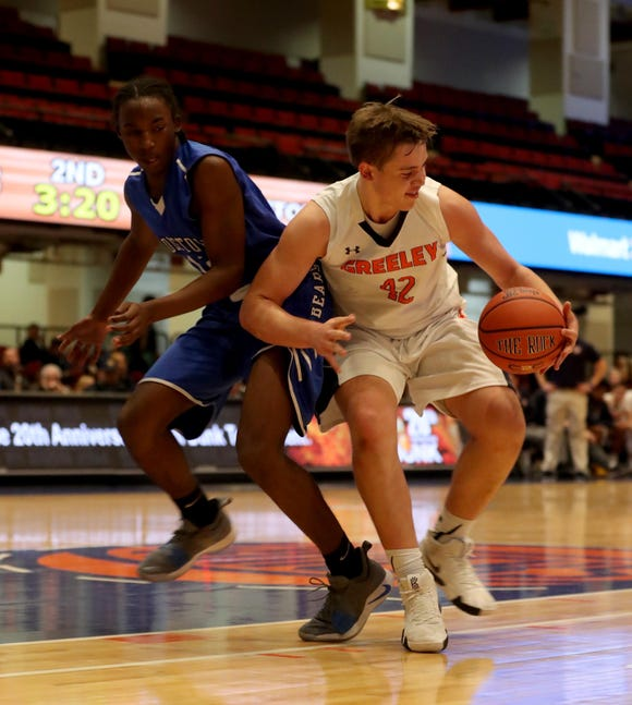 Nicholas Townsend of Horace Greeley controls the ball against Middletown during a Slam Dunk Basketball Tournament challenge game at the Westchester County Center in White Plains Dec. 22. 2018. Greeley defeated Middletown 72-53.