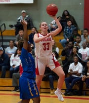 Conrad's Julie Kulesza (33) with a shot attempt in their 64-33 win against Sussex Central.