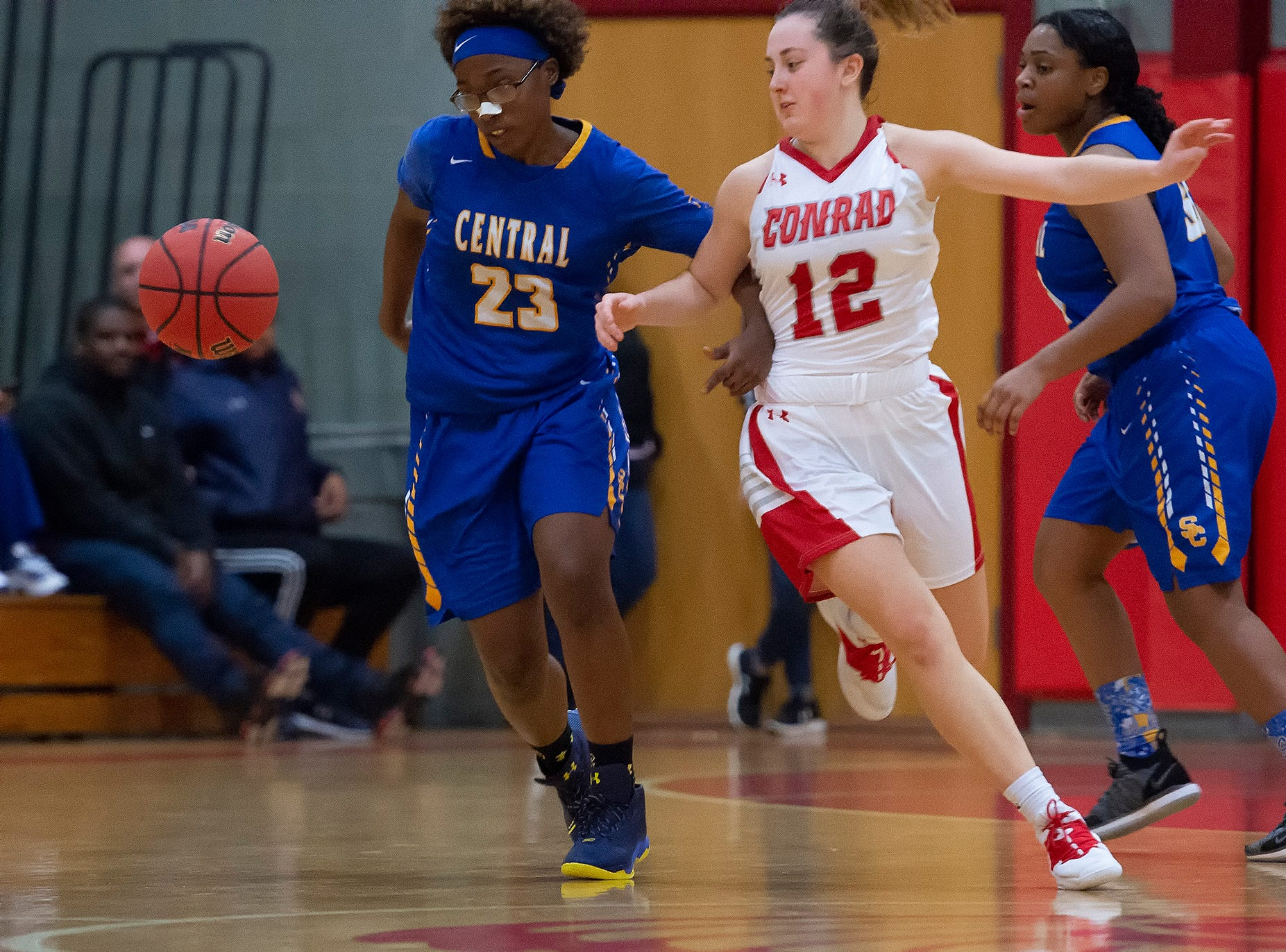 Conrad's Alyssa Faville (12) works to steal the ball from Sussex Central's Raeonna Stratton (23) in their game at Conrad Schools of Science.