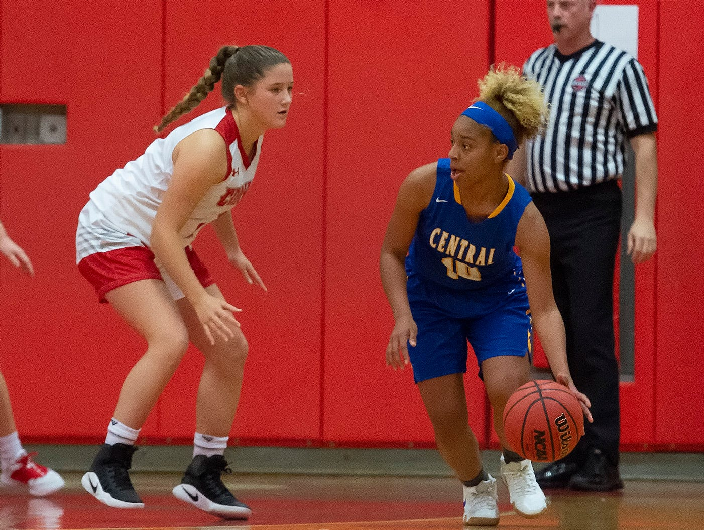 Sussex Central's Azayah Garrison (10) is guarded by Conrad's Erin Ranegan (2) in their game at Conrad Schools of Science.