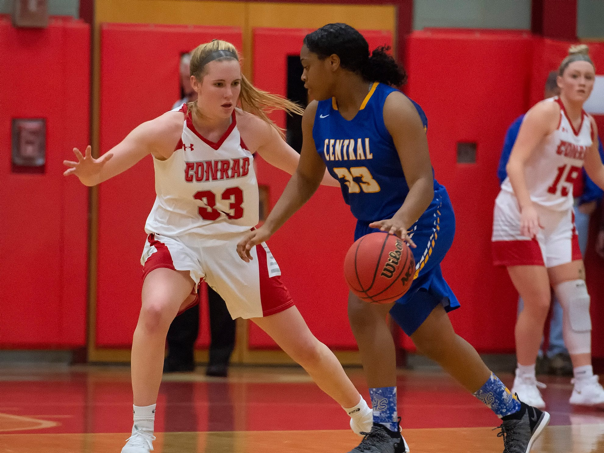 Conrad's Julie Kulesza (33) guards Sussex Central's Ambria Stratton (33) in their game at Conrad Schools of Science.