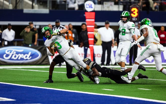 Cuero's Jordan Whittington scores a touchdown during Friday's 4A division II state championship game against Pleasant Grove at AT&T Stadium in Arlington.