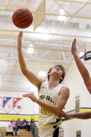 Tri-Valley's Jack Lyall puts up a shot against Morgan Friday night in Dresden.