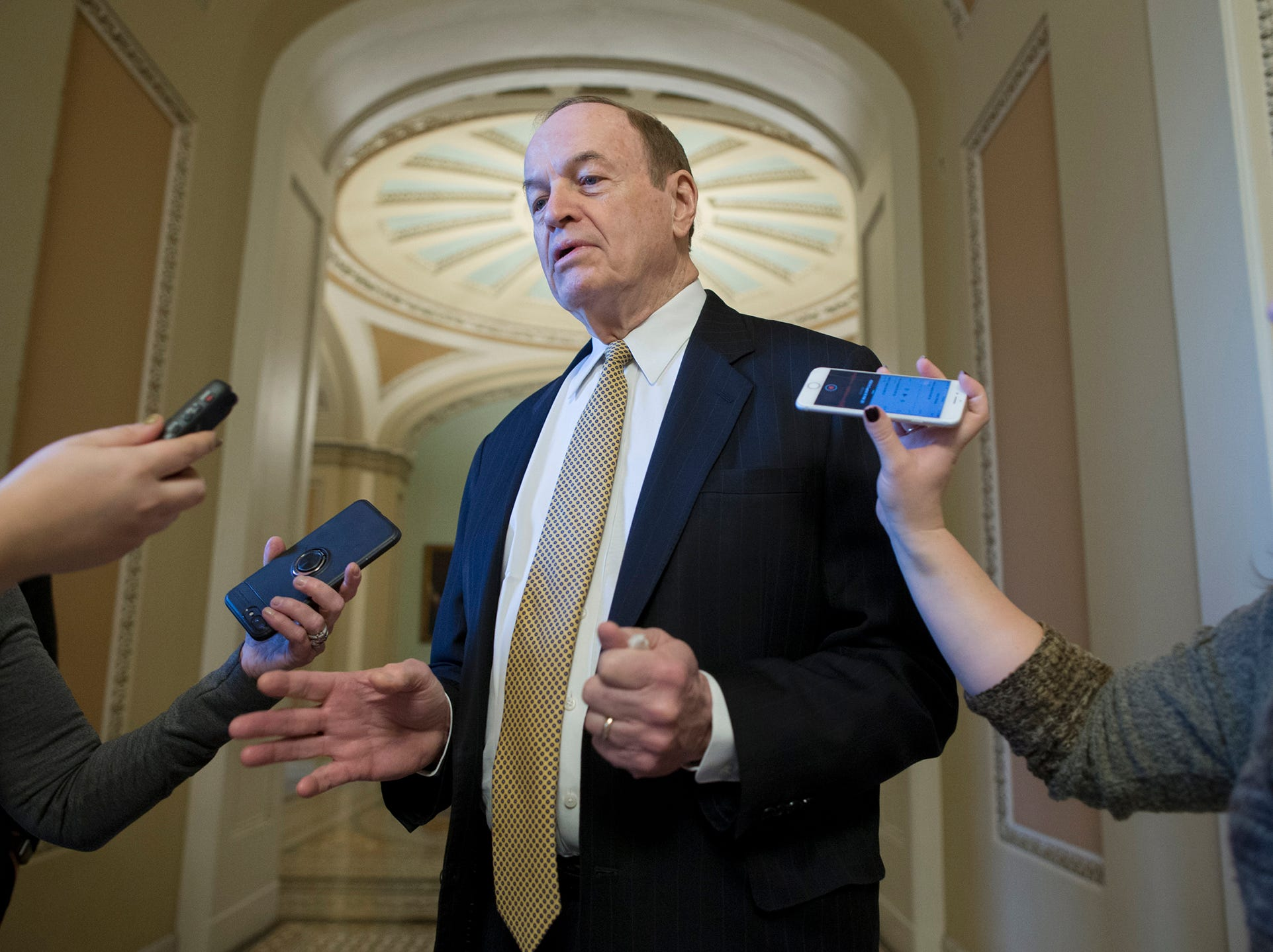 Chairman of the Senate Committee on Appropriations Republican Richard Shelby (C) speaks to members of the news media shortly before leaving to attend a meeting at the White House held by US President Donald J. Trump, on Capitol Hill, Friday. President Trump rejected a continuing resolution to fund the federal government through 08 February 2019, threatening a partial shutdown unless funding is included for his border wall.