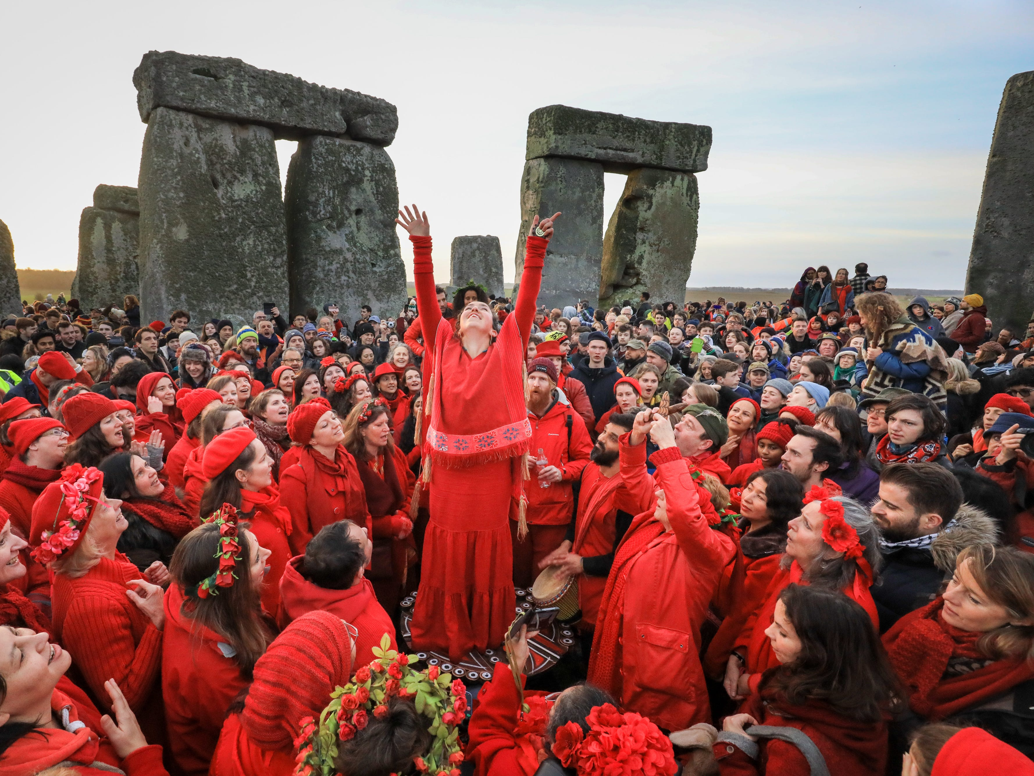 Members of the Shakti Sings choir sing as druids, pagans and revelers gather in the centre of Stonehenge.