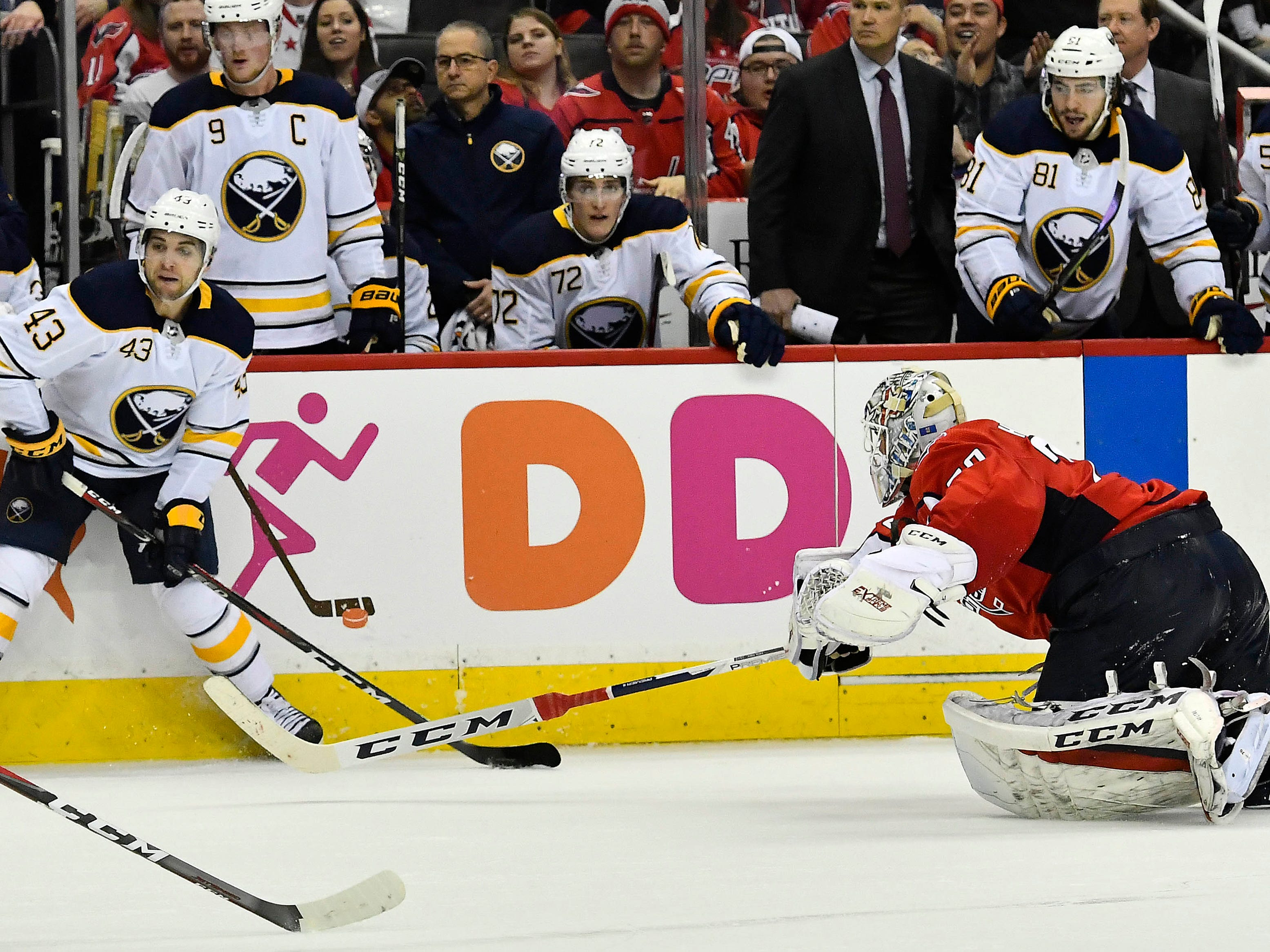 Dec. 21: Washington Capitals goaltender Braden Holtby, way out of his crease, makes a save against Buffalo Sabres left wing Conor Sheary near the blue line.