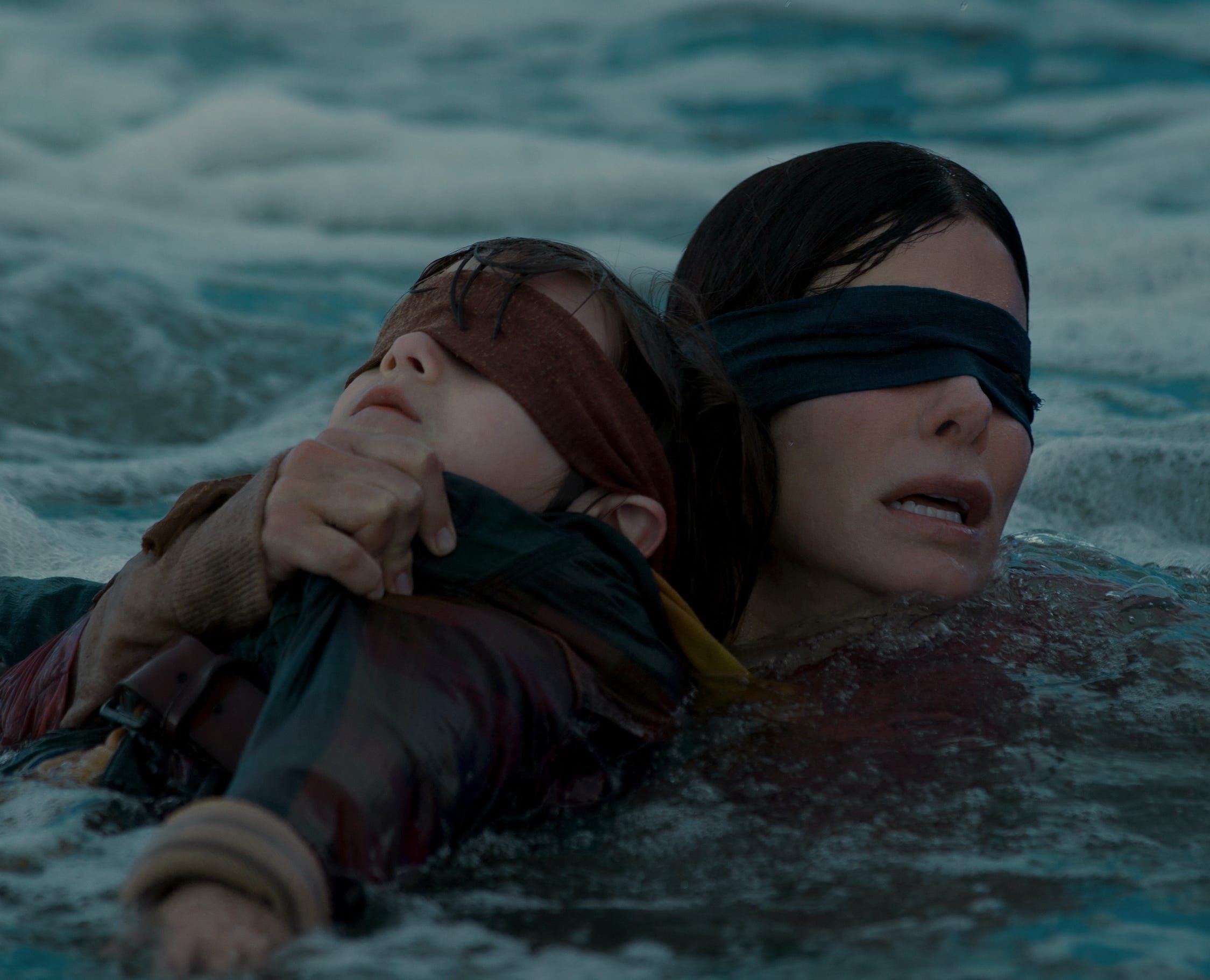"Blindfolded Sandra Bullock leads the rescue in ""Bird Box."""