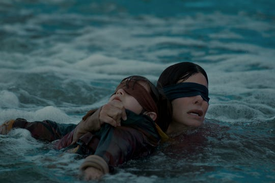 "Blindfolded Sandra Bullock leads the rescue in ""Bird Box."""