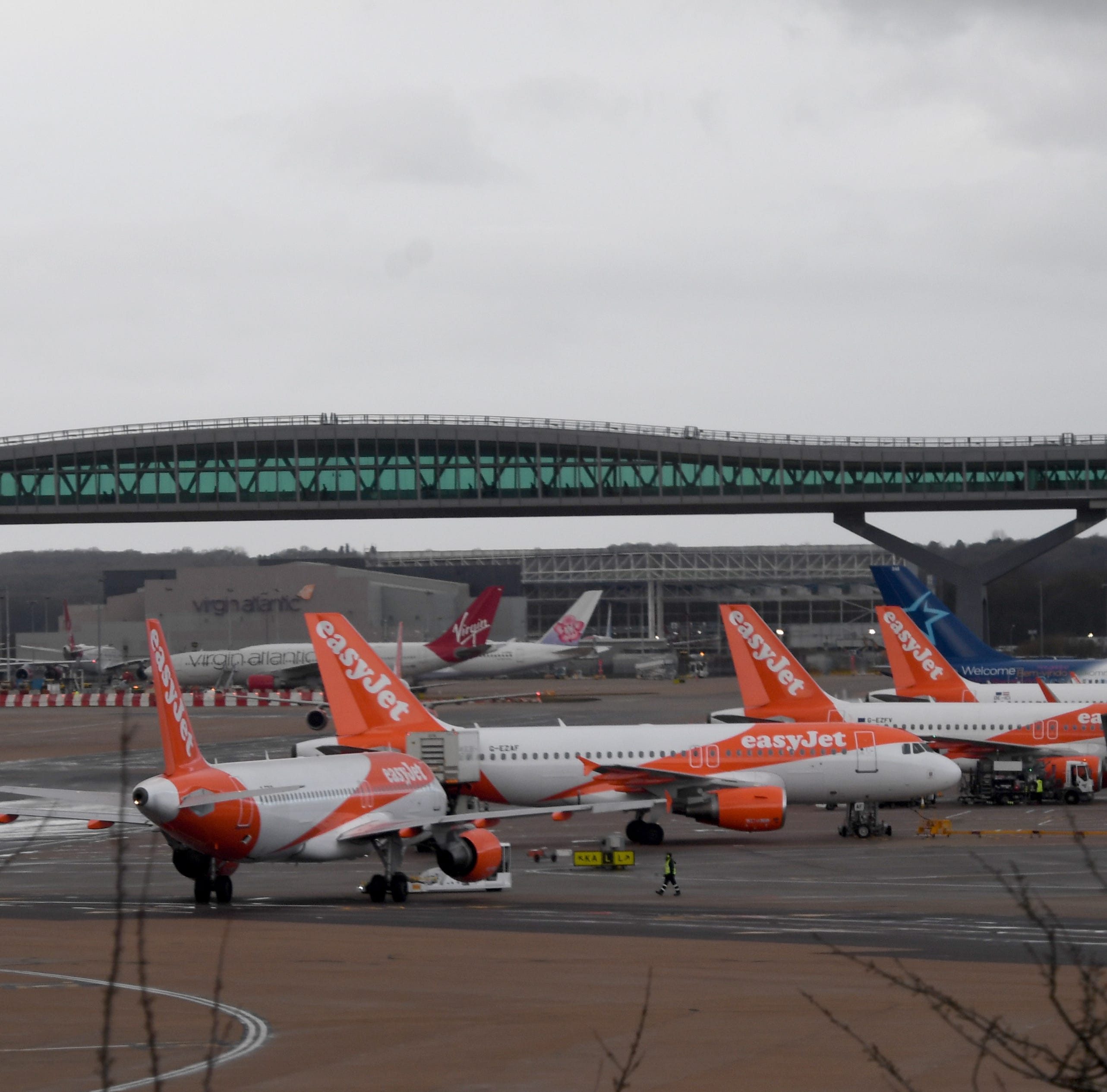 Planes are parked on a tarmac of the Gatwick airport in Sussex, southeast, England, 21 December 2018. Britain's second busiest airport Gatwick was shut down by authorities after sightings of drones flying but has since then reopened.