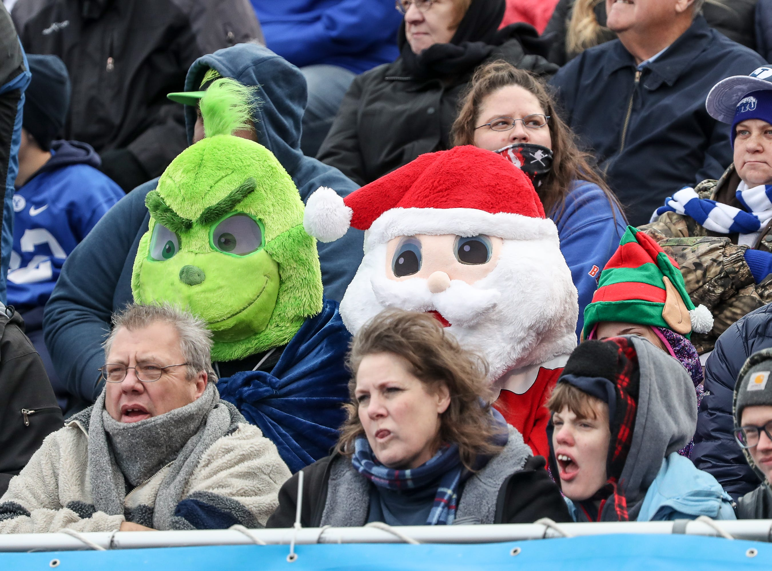 The Grinch and Santa Claus enjoy first half action between the BYU Cougars and the Western Michigan Broncos at the Famous Idaho Potato Bowl on Dec. 21, 2018 at Albertsons Stadium in Boise, Idaho.