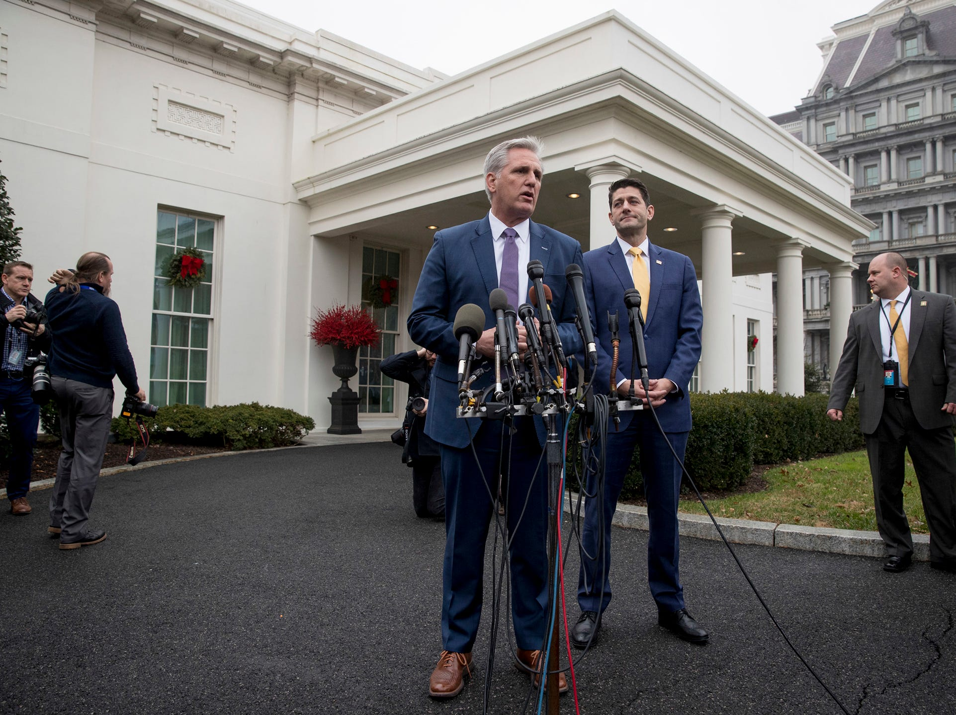 House Majority Leader Kevin McCarthy of Calif., center, accompanied by House Speaker Paul Ryan of Wis., center right, speaks to reporters outside the West Wing of the White House following a meeting with President Donald Trump on border security.
