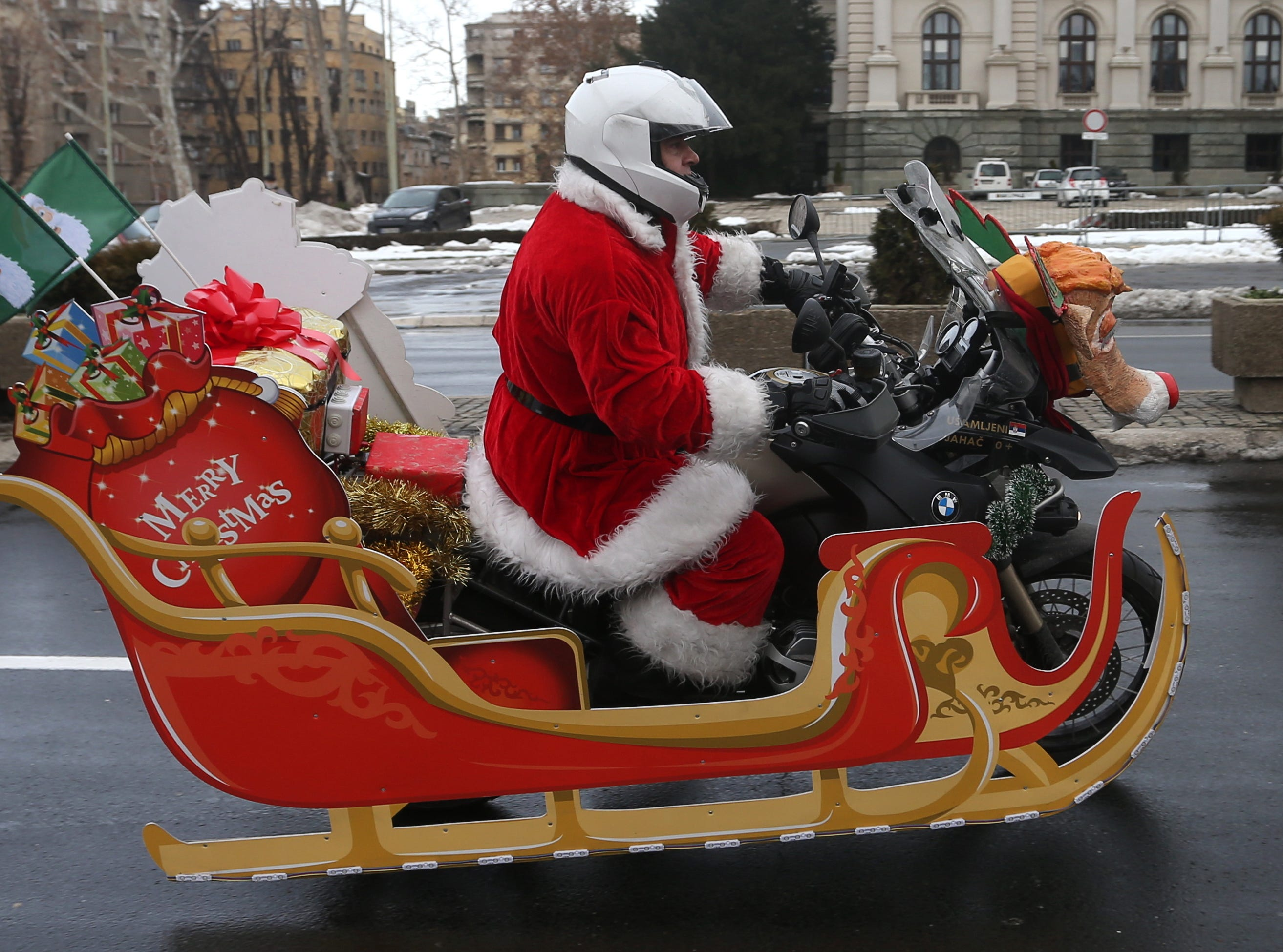 Serbian motorcyclists dressed in Santa costume drives through the streets of Belgrade, Serbia on Dec. 22, 2018. A group of Serbian motorcycle enthusiasts gathered in the Serbian capital for a joint ride to the bring Christmas gifts for underprivileged children.