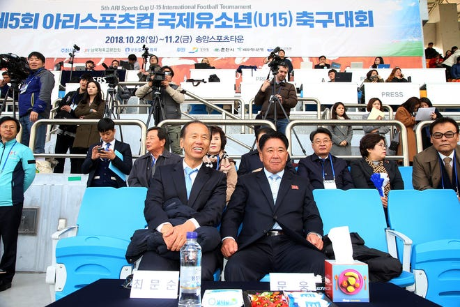 Gangwon province Gov. Choi Moon-soon and North Korean official Mun Ung attend the Ari Sports Cup tournament in Chuncheon, South Korea, on Oct. 29.