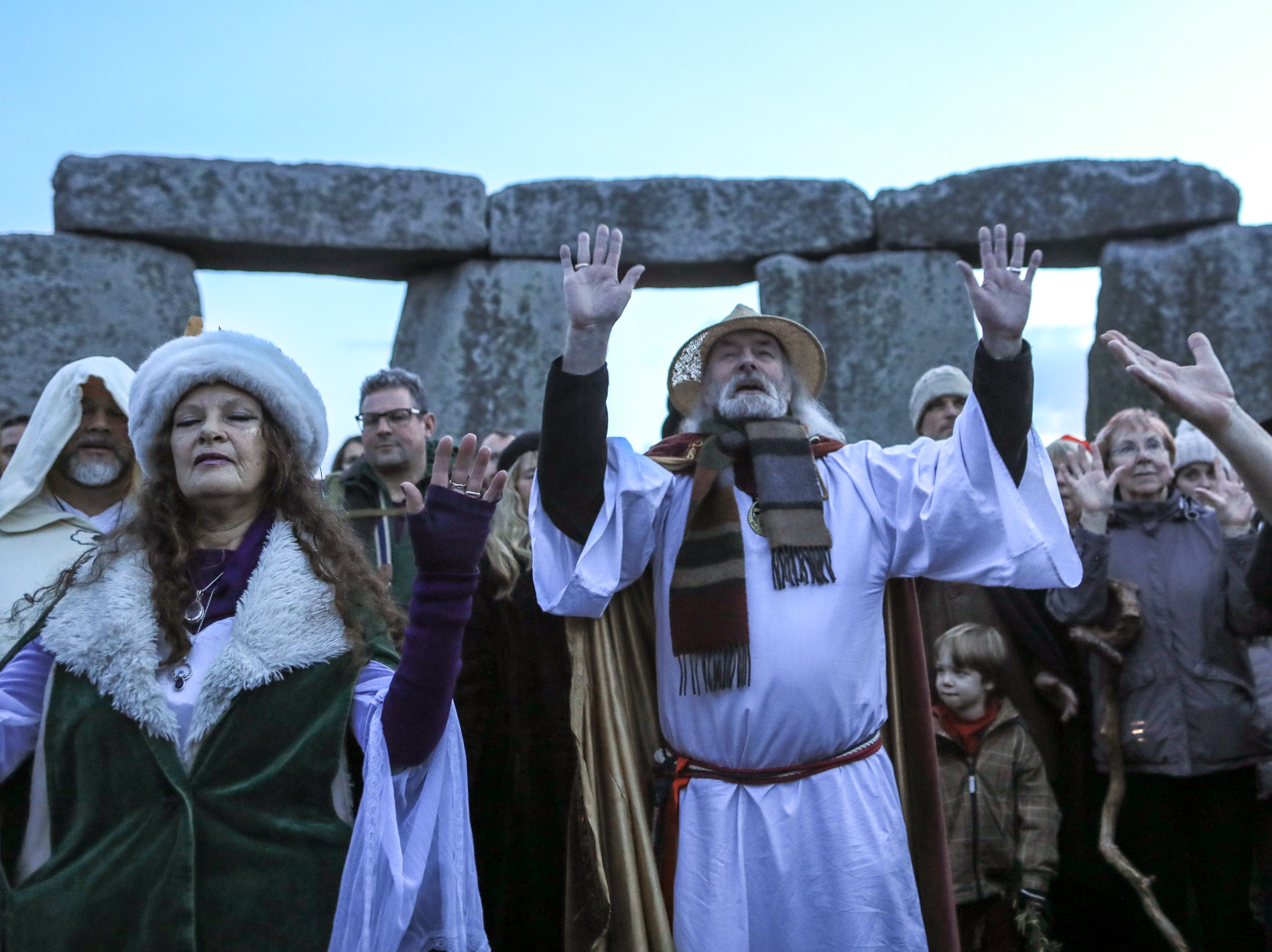 Rollo Maughfling, Archdruid of Stonehenge and Britain conducts as ceremony as druids, pagans and revelers gather in the centre of Stonehenge, hoping to see the sun rise, as they take part in a winter solstice ceremony.