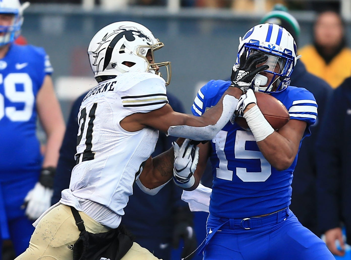 Brigham Young Cougars wide receiver Aleva Hifo (15) catches a pass against Western Michigan Broncos defensive back Stefan Claiborne (21) during the Potato Bowl.