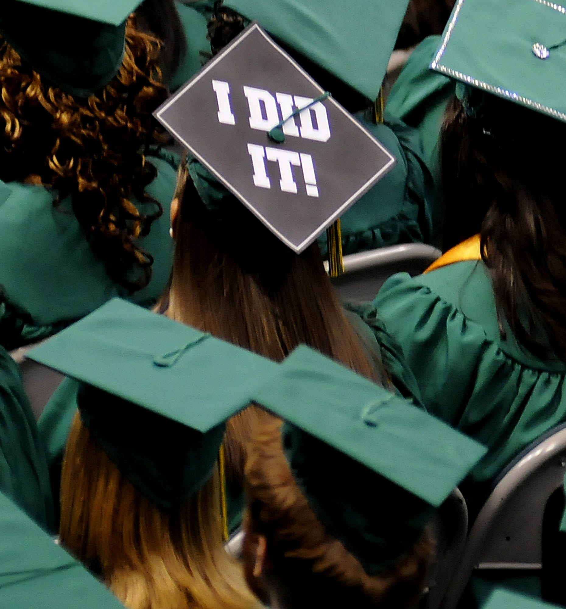 A graduate sends a message on her mortar board cap as the University of Alabama at Birmingham holds May 2012 commencement exercises for their graduates.