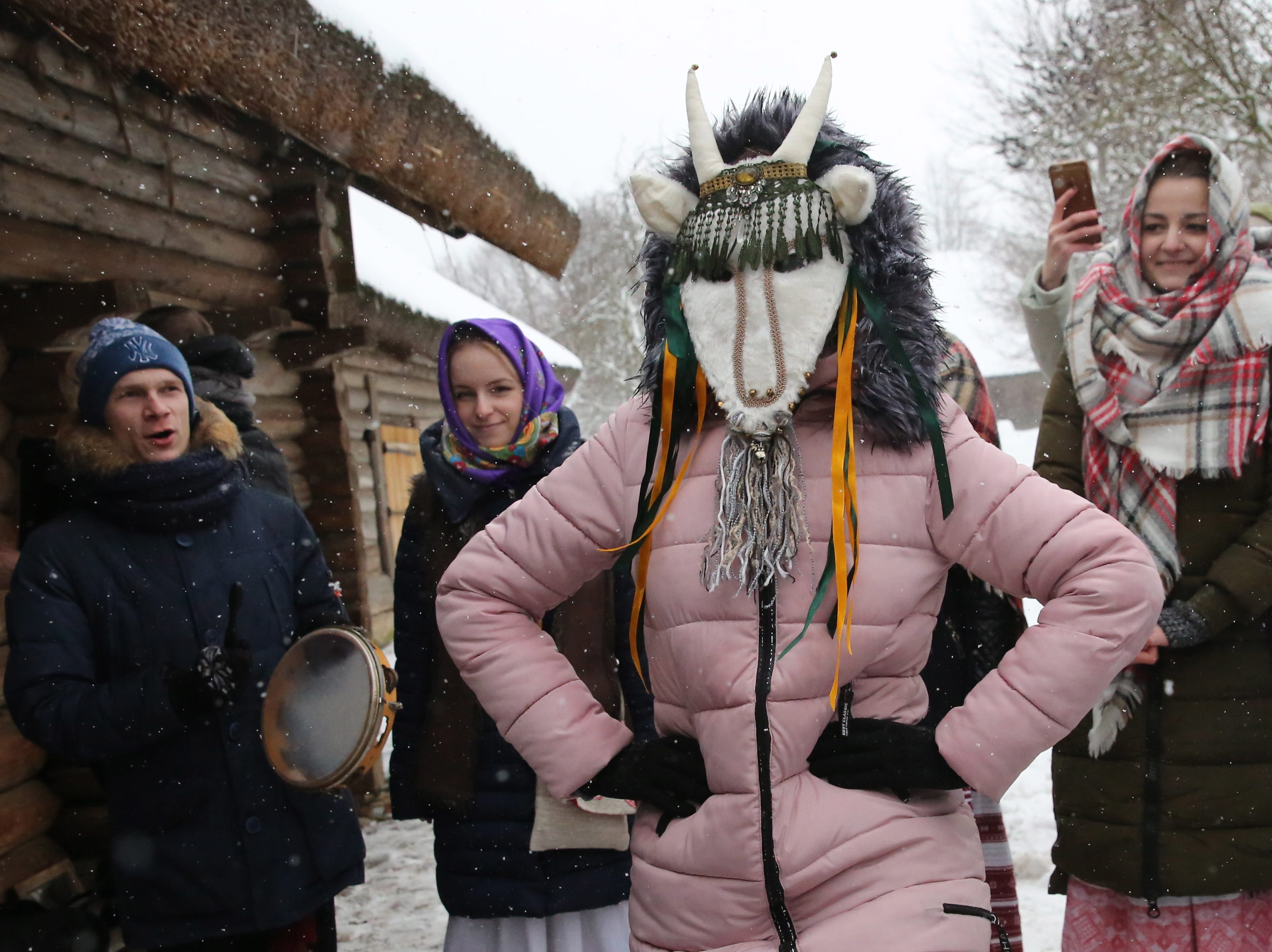 Belarussian artists wearing traditional costumes sing carol songs during Koliady celebrations in the village of Ozertso, some 5 km from Minsk, Belarus on Dec. 22, 2018. Koliady is an ancient pagan holiday initially celebrated on winter solstice.