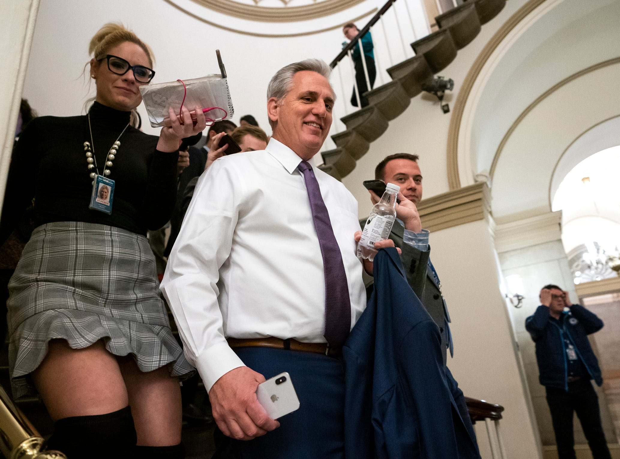 Republican Majority Whip from California Kevin McCarthy (C) leaves the Capitol, Thursday, for the White House to negotiate a budget vote to avert a government shutdown in the US Capitol. The Senate passed a continuing resolution on Wednesday, to keep the government open until February 2019. Others are not identified members of the media.