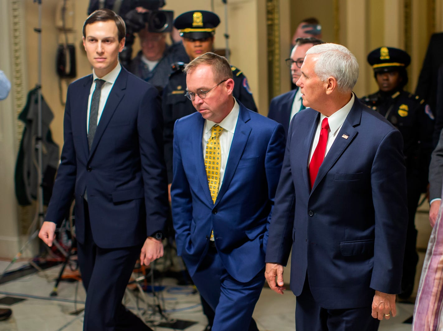 Vice President Mike Pence, right, acting White House Chief of Staff Mick Mulvaney, center, and Senior Advisor to US President Donald J. Trump, Jared Kushner, left, walk from the House of Representatives to the Senate at the US Capitol on Friday.