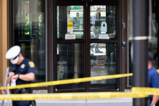 Police investigate the scene after a multiple fatality shooting at the Fifth Third Bank building on Fountain Square after a shooting with multiple fatalities on Sept. 6, 2018, in downtown Cincinnati.
