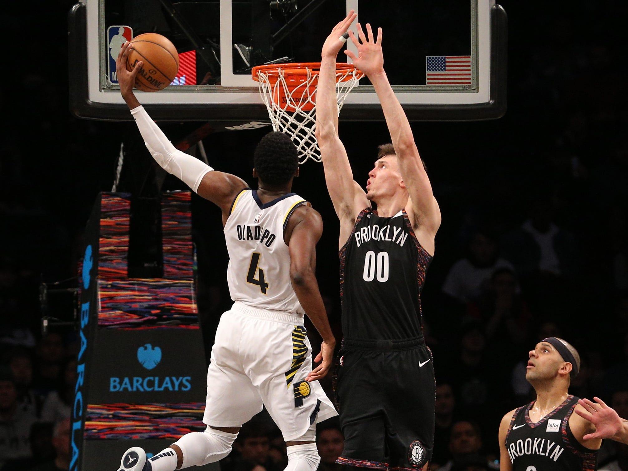 Dec. 21: Pacers guard Victor Oladipo (4) throws down a ferocious one-handed flush over Nets defender Rodions Kurucs (00) during the fourth quarter in Brooklyn.