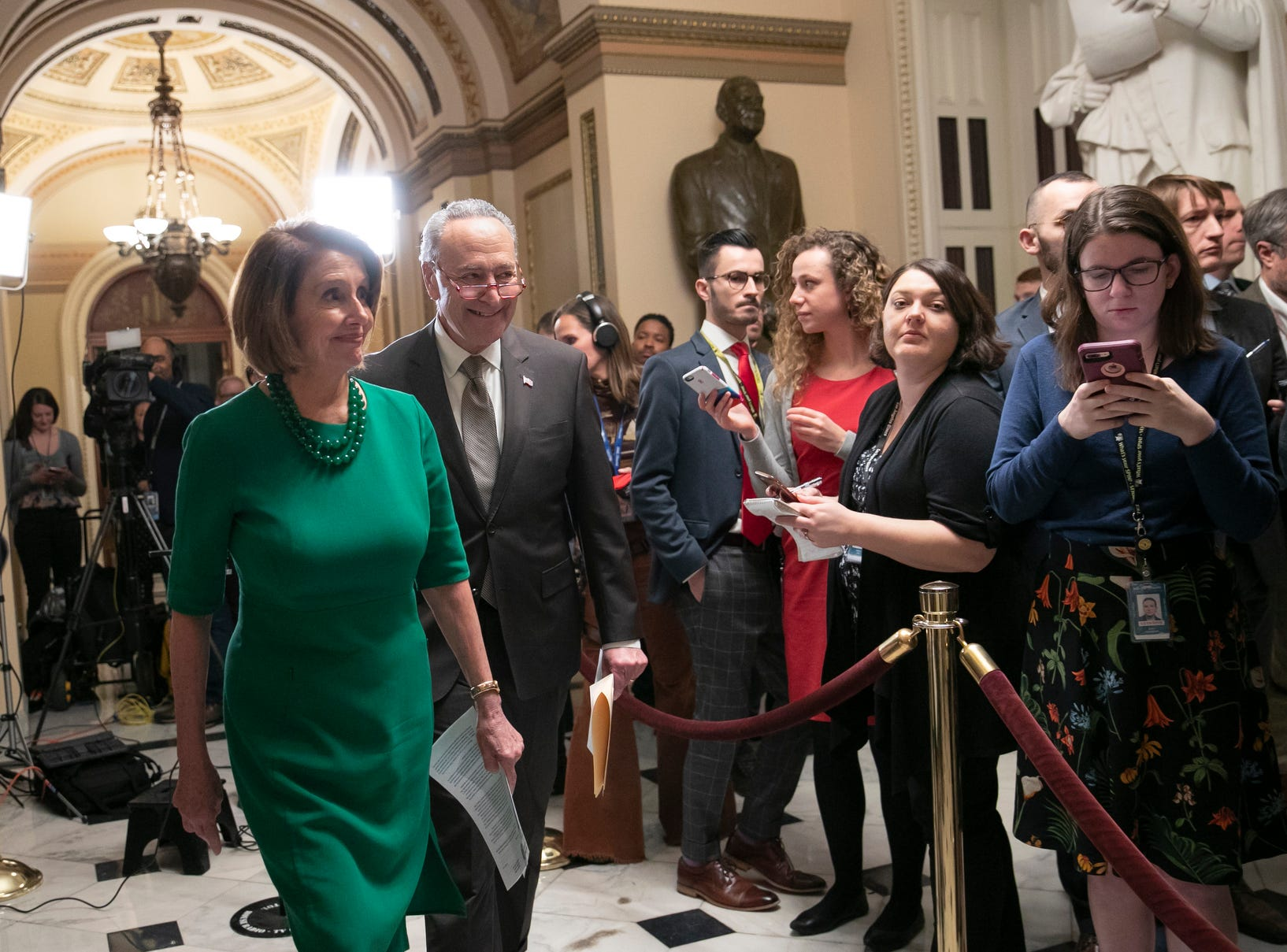 House Democratic Leader Nancy Pelosi of California, the speaker-designate for the new Congress, and Senate Minority Leader Chuck Schumer, D-N.Y., leave after talking to reporters as a revised spending bill is introduced in the House that includes $5 billion demanded by President Donald Trump for a wall along the U.S.-Mexico border, as Congress tries to avert a partial shutdown, in Washington, on Dec. 20, 2018.