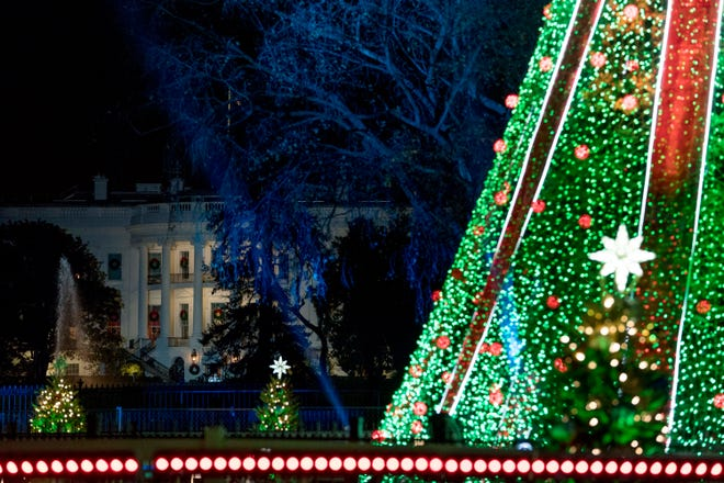 The National Christmas Tree is lit following a ceremony at the Ellipse near the White House in Washington, Wednesday, Nov. 28, 2018.