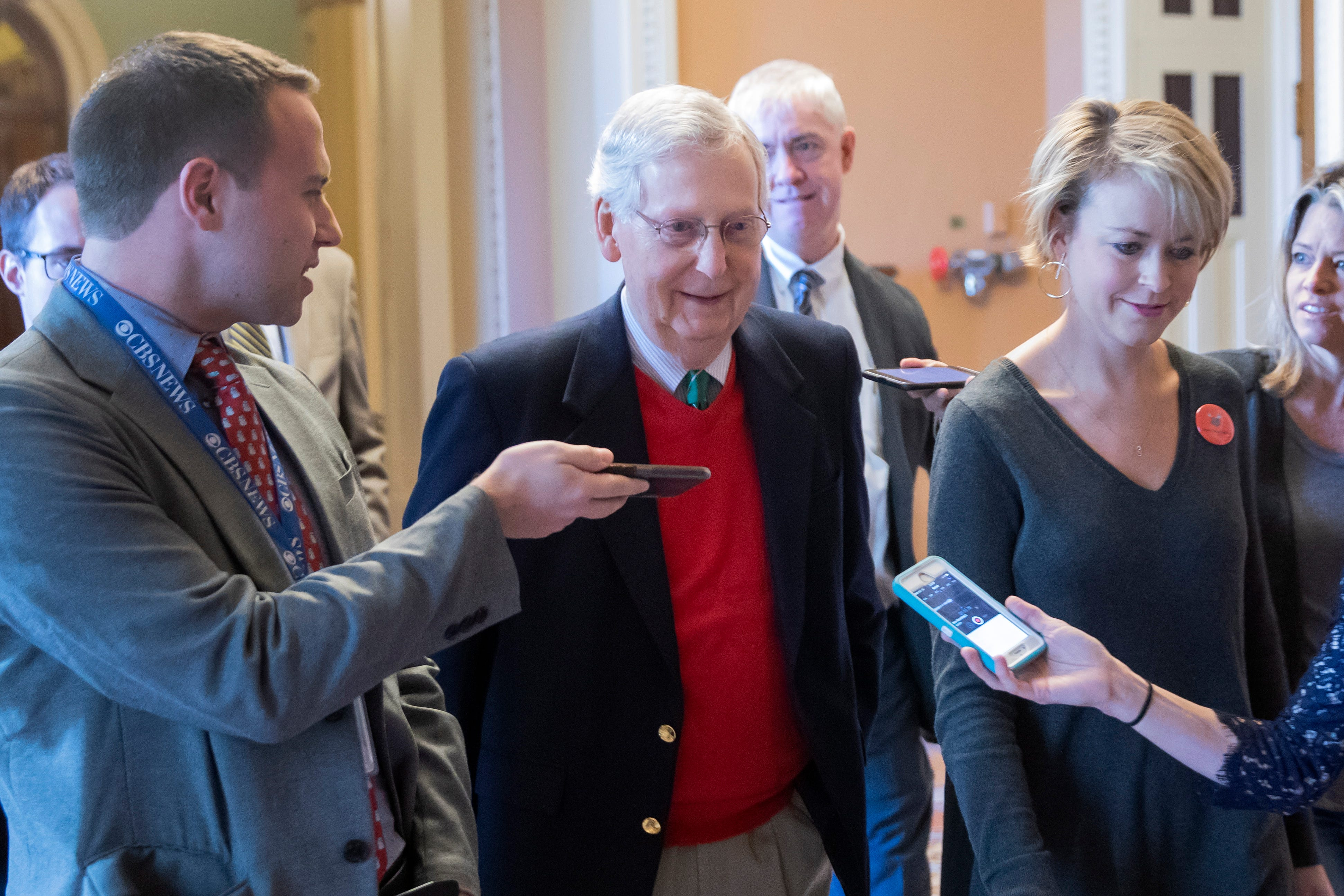 Senate Majority Chief, Republican Mitch McConnell, heart, is surrounded by reporters after leaving the Senate chamber at the US Capitol in Washington, DC on Dec. 22, 2018.