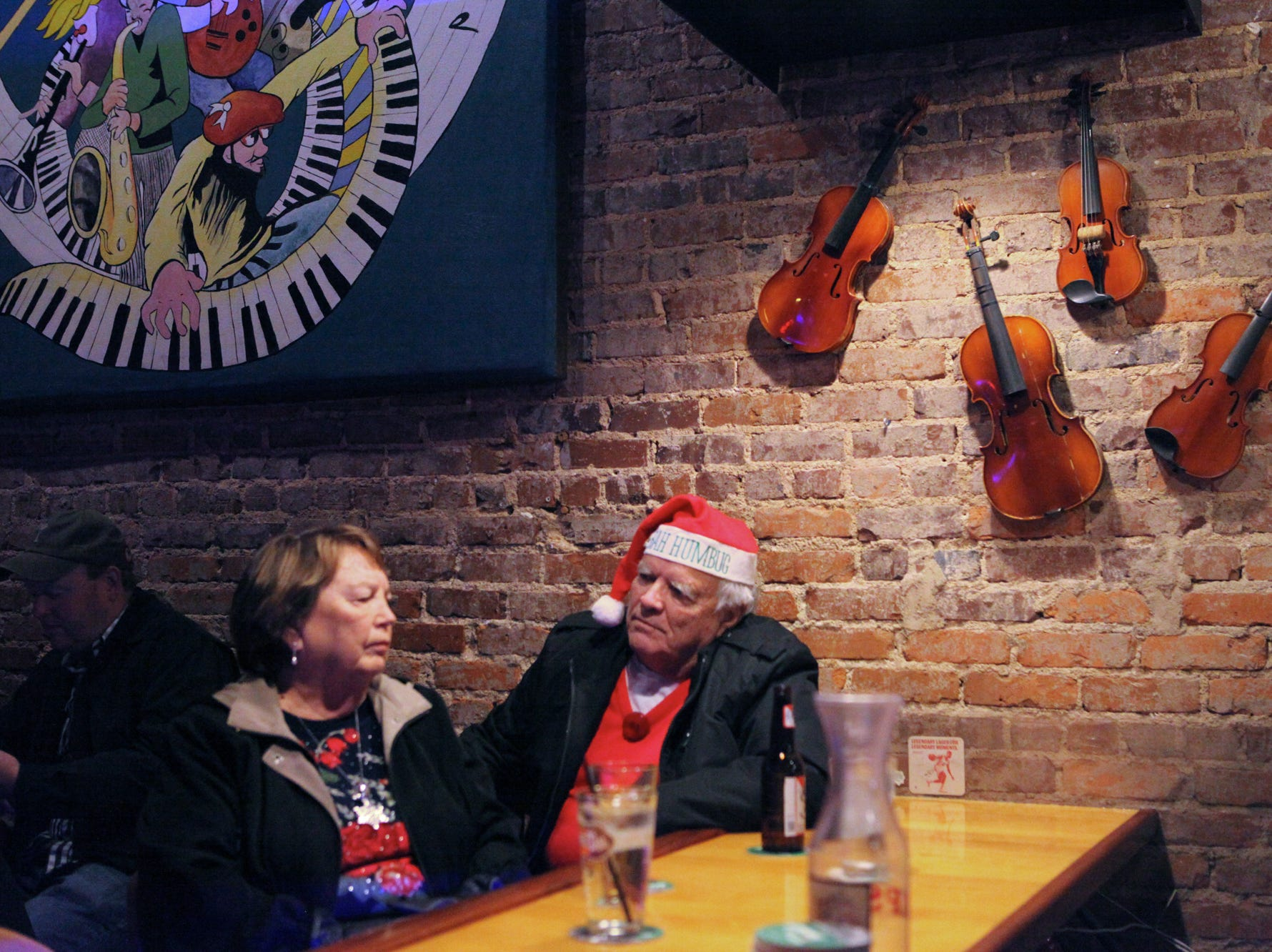 Linda Watts and Larry Watts. Simple Syrup performed their Holiday Jam at Smiley's Acoustic Cafe on December 22, 2018.
