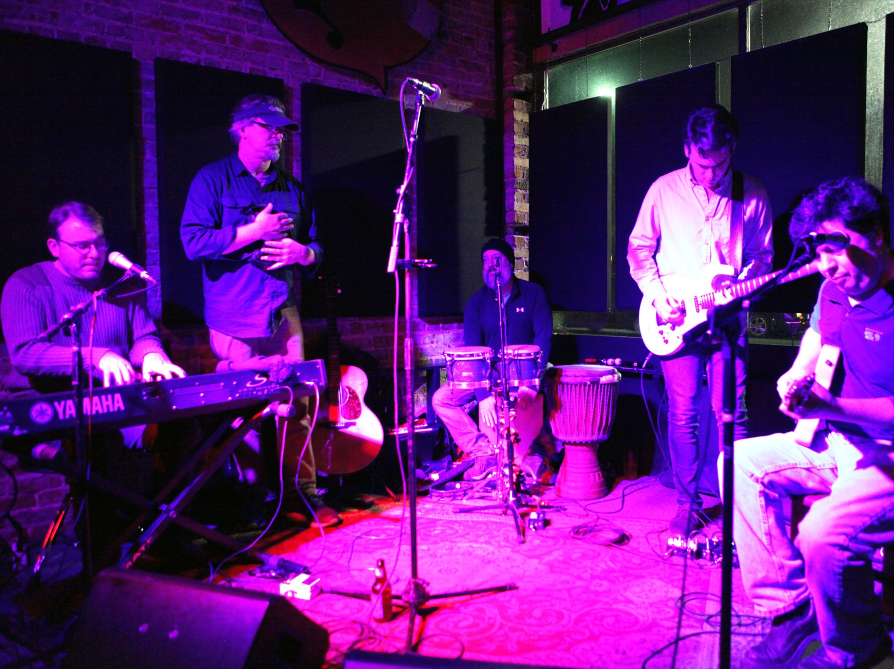 Adam McFarland Ph.D, Doug Jones, Jeff Holland, Ben Taylor and Charles Hedgepath (left to right). Simple Syrup performed their Holiday Jam at Smiley's Acoustic Cafe on December 22, 2018.
