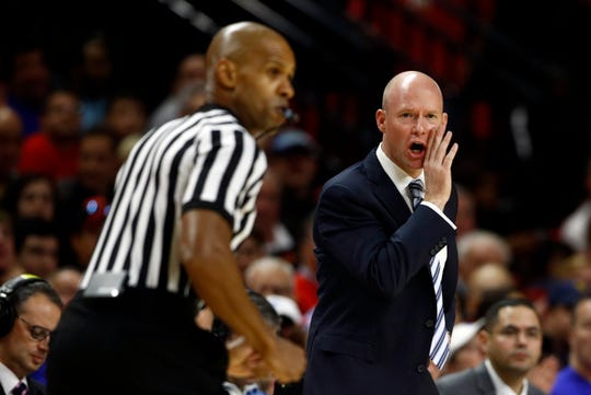 Seton Hall head coach Kevin Willard, right, directs his players in the first half of an NCAA college basketball game against Maryland
