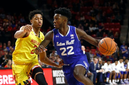 Seton Hall guard Myles Cale, right, drives past Maryland guard Aaron Wiggins