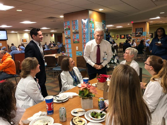 John Lloyd, co-CEO of Hackensack Meridian Health, chats with employees at Jersey Shore University Medical Center in Neptune.