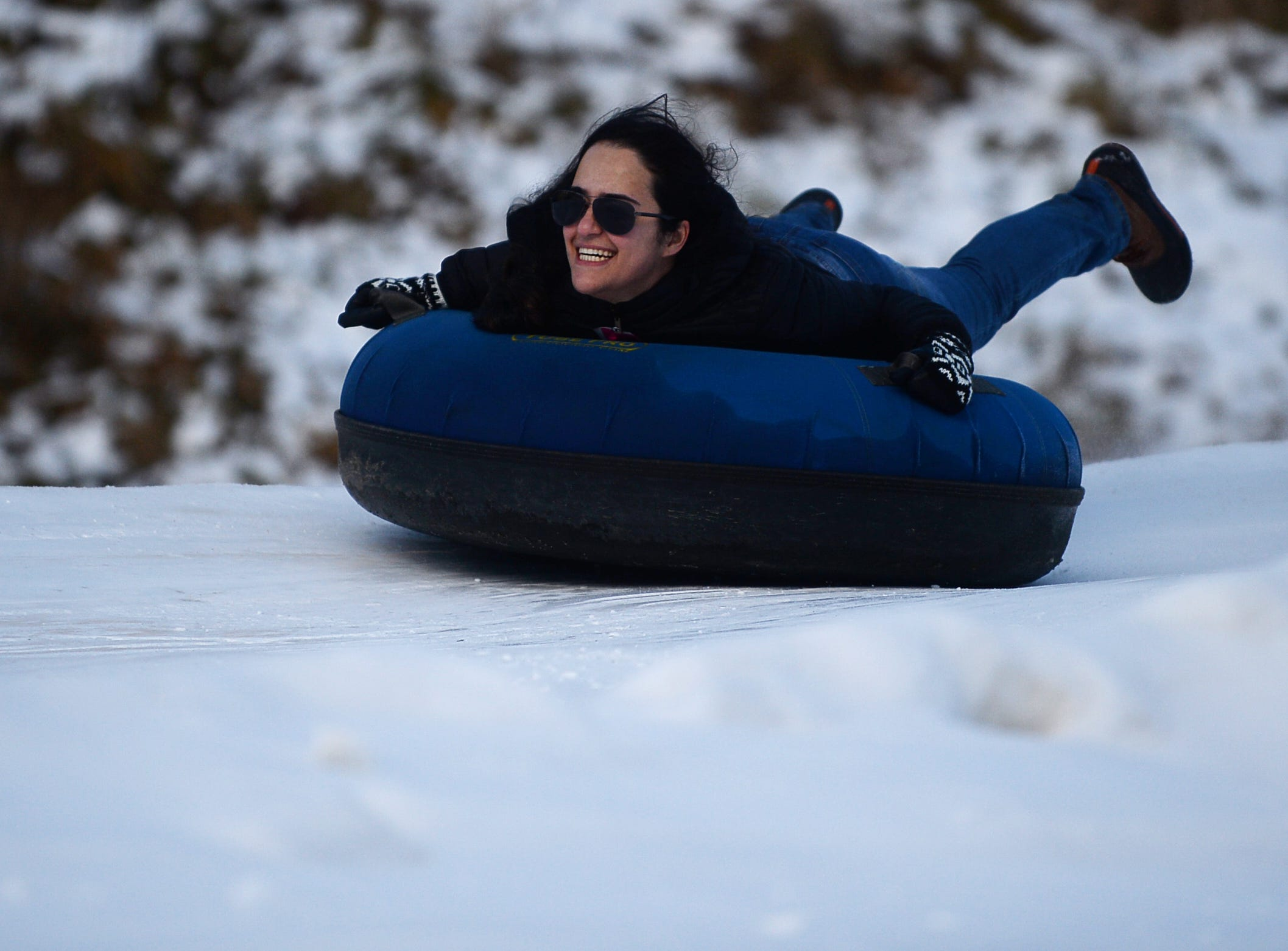 Elly Konjkav slides down the tubing hill at the Zip N Slip Snow Tubing Park in Mars Hill Dec. 22, 2018.