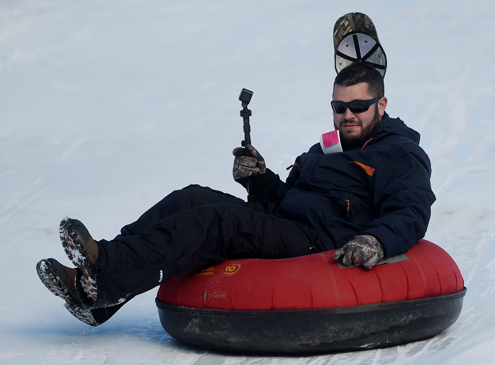 Kyle Hebert loses his hat as he slides down the hill at the Zip N Slip Snow Tubing Park in Mars Hill Dec. 22, 2018.