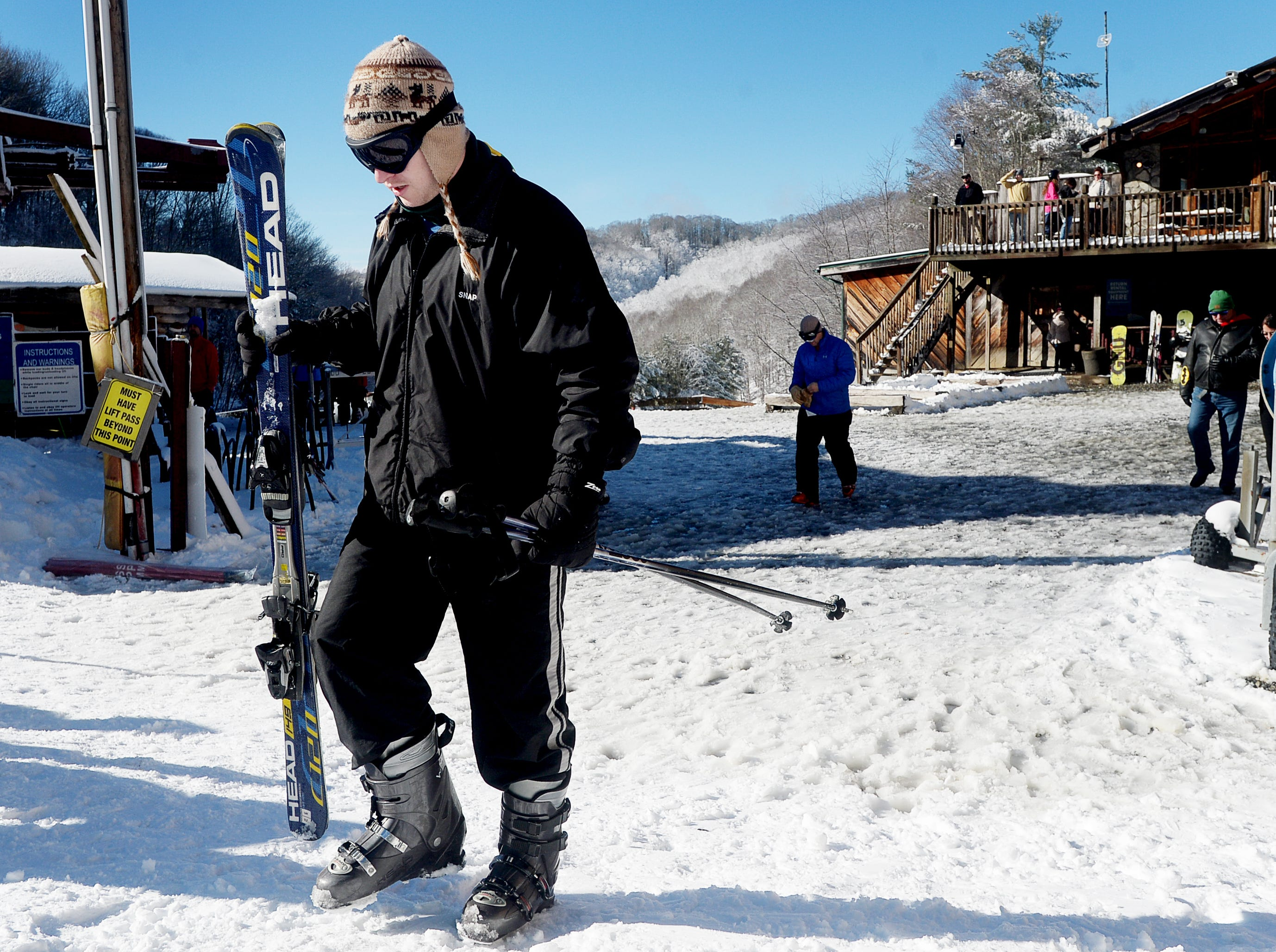 Charles Waddy, of Georgia, carries his skis as he heads to the chairlift at Wolf Ridge Ski Resort in Mars Hill Dec. 22, 2018.