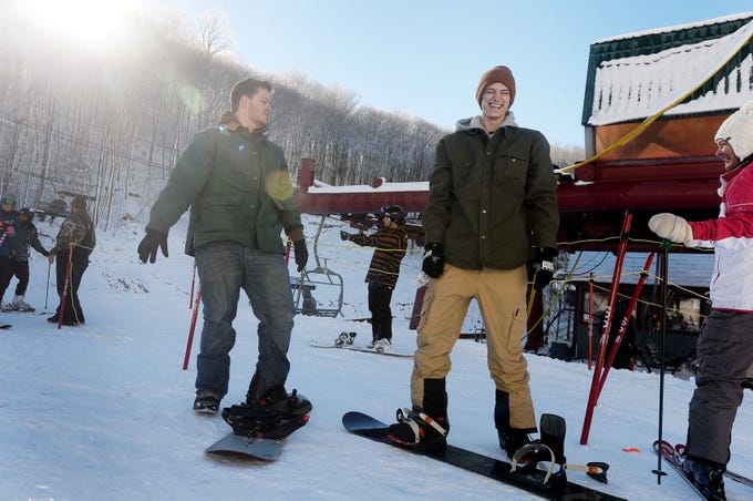 Brothers Joey, left, and Andrew Sears prepare to hit the slopes at Wolf Ridge Ski Resort while home for winter break in Mars Hill Dec. 22, 2018.