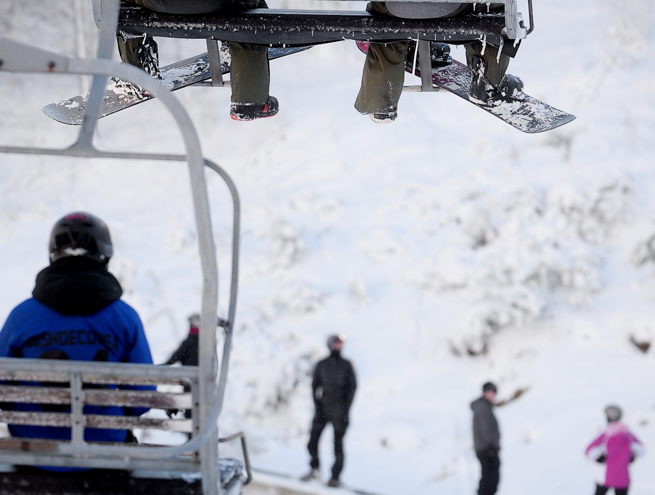 Skiers and snowboarders ride the lifts at Wolf Ridge Ski Resort in Mars Hill Dec. 22, 2018.