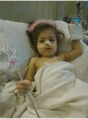 In this 2011 photo, 1-year-old Hazel Chaltraw is shown recovering from emergency surgery at Bronson Methodist Hospital in Kalamazoo.
