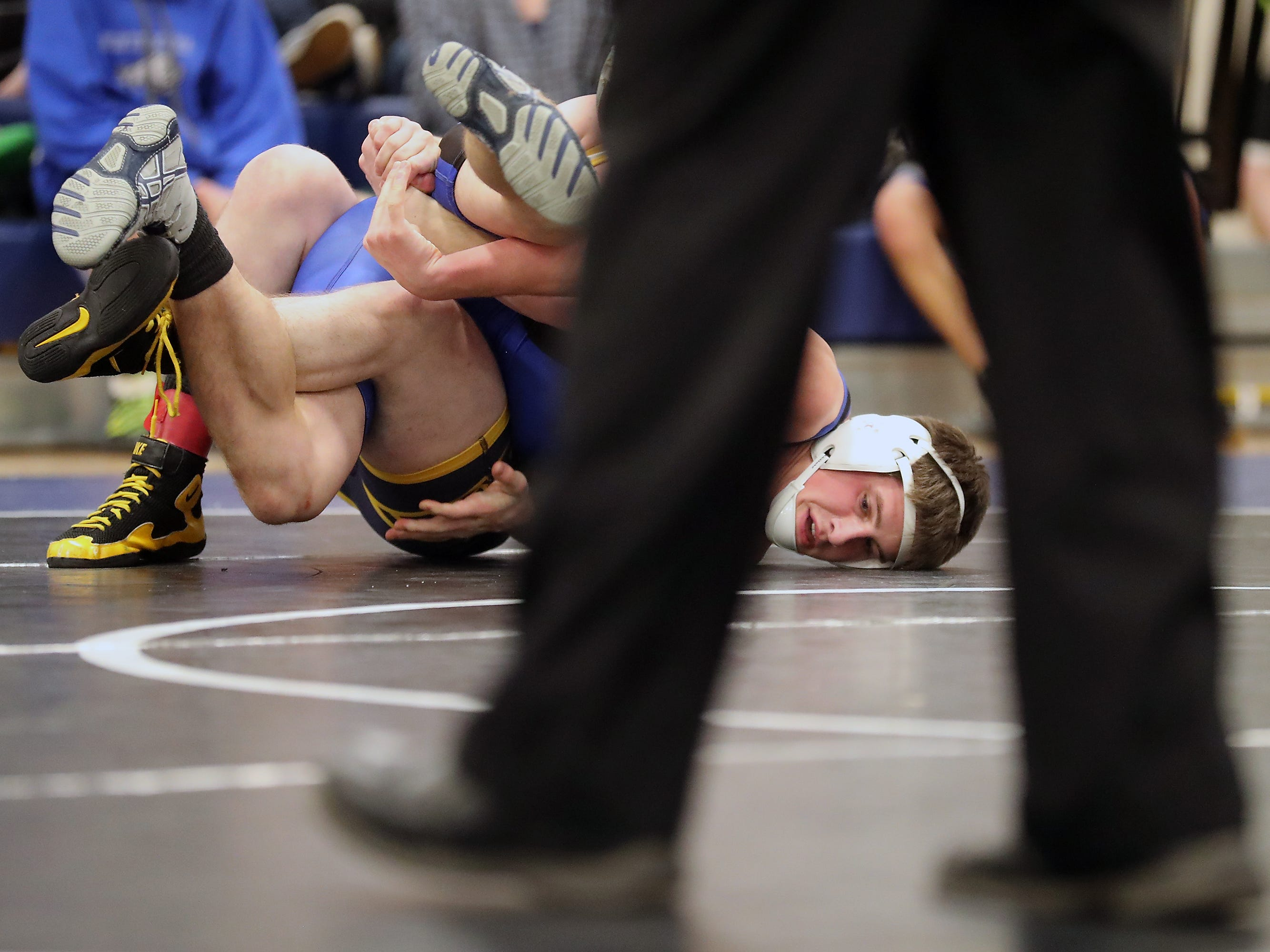 North Mason's Cole Varick and Aberdeen's Bodie Wharton grapple for the first place finish in the 152-pound weight class at the North Mason Classic in Belfair on Saturday, December 22, 2018.