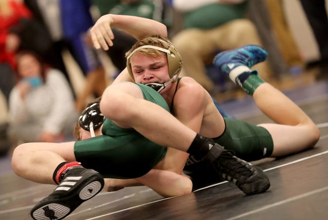 Klahowya wrestler Hayden Steele puts Tumwater's Brooks Greenwell on his back during the 138-pound title match Saturday at the North Mason Classic.