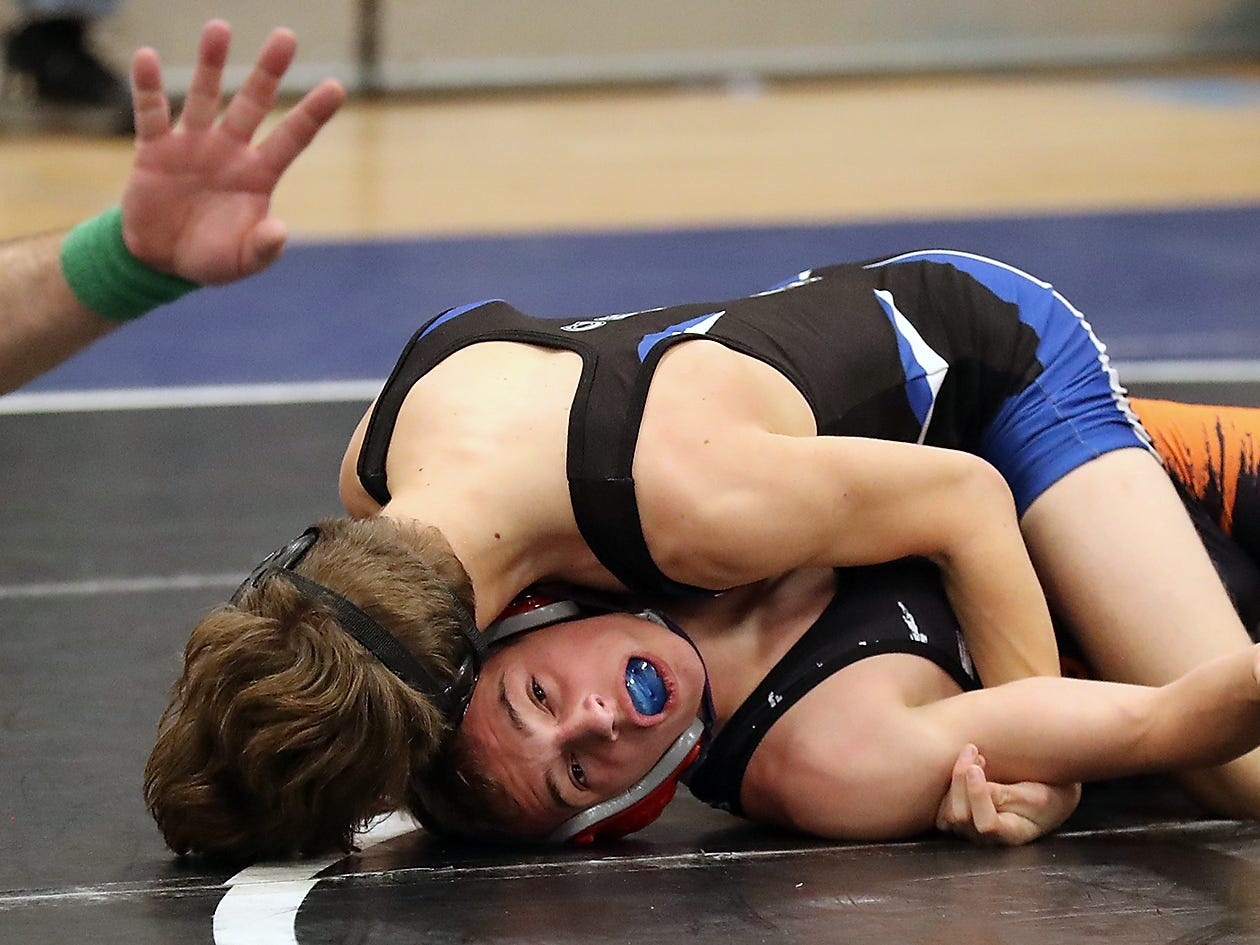 Central Kitsap's Conrad Bellon (bottom) wrestle's Eatonville's E. Zhennia-Cyrus for the finals in the 106-pound class at the North Mason Classic in Belfair on Saturday, December 22, 2018.