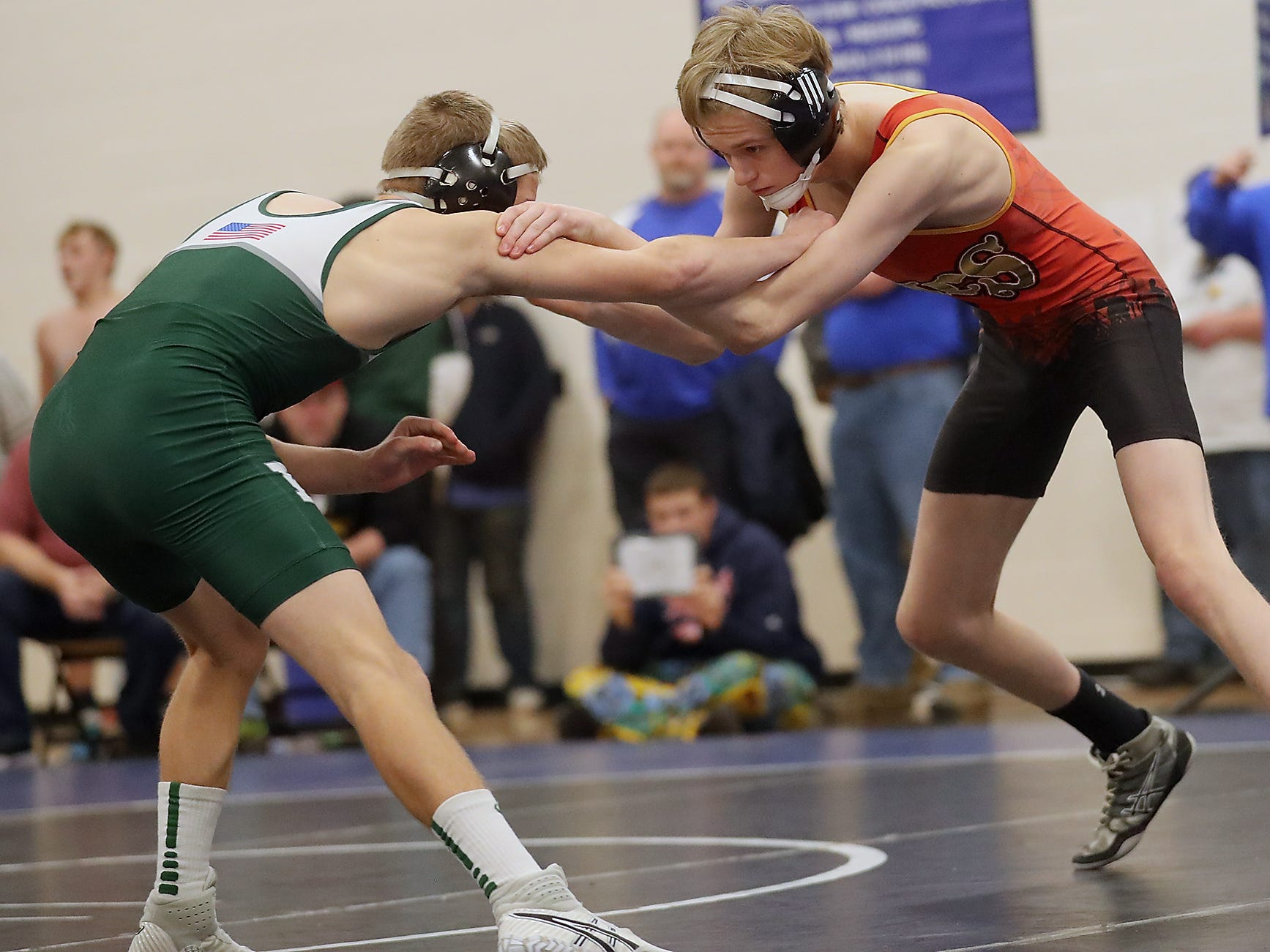 Kingston's Dalton Tellinghuisen (right) grapples with Port Angeles's Daniel Busclen for the final of the 126-pound weight class at the North Mason Classic in Belfair on Saturday, December 22, 2018.