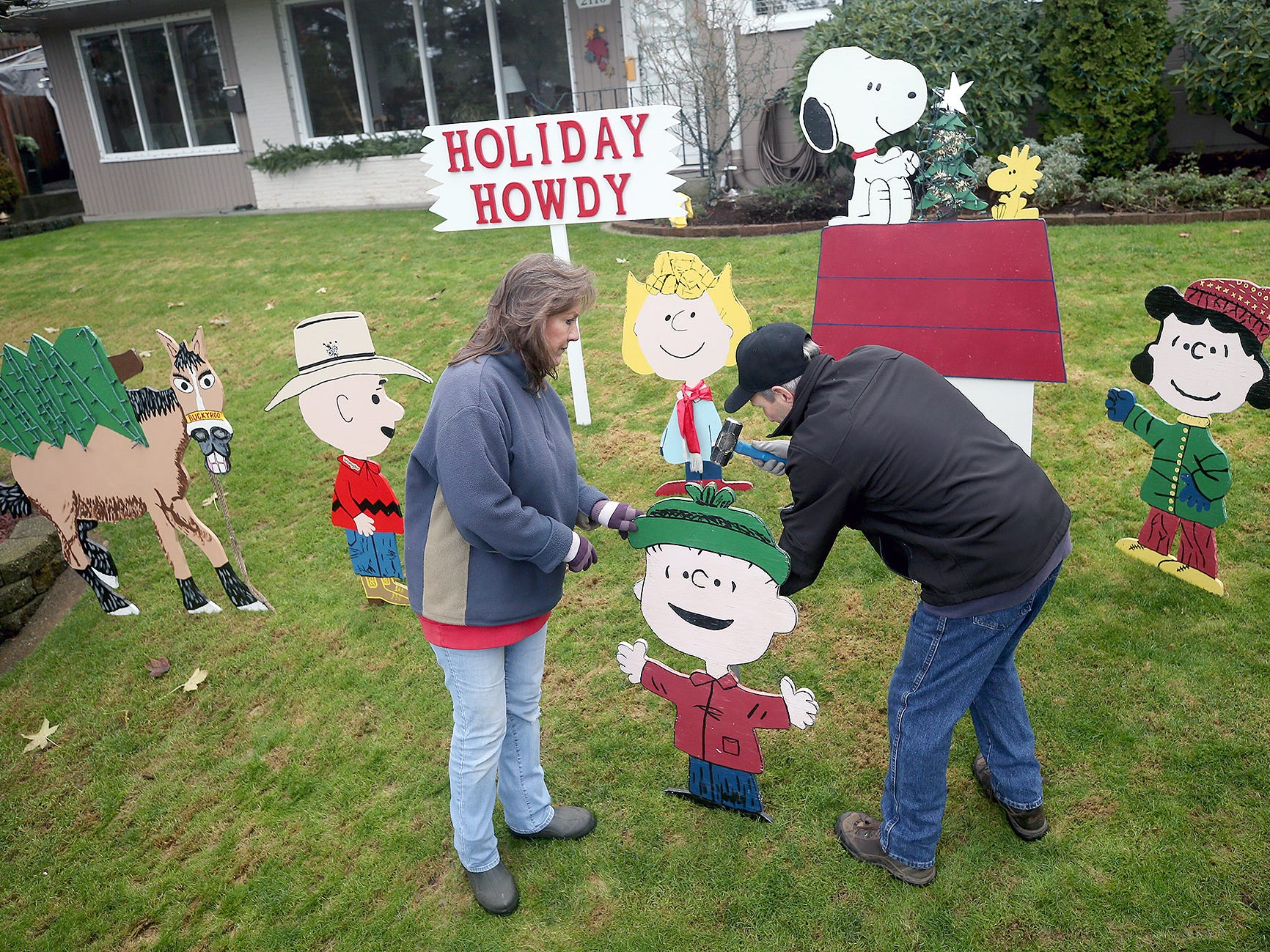 Michelle and Rich Adamski put up there annual Peanuts characters Christmas display at the East Bremerton home on Friday, November 23, 2018. Rich made the popular figures.