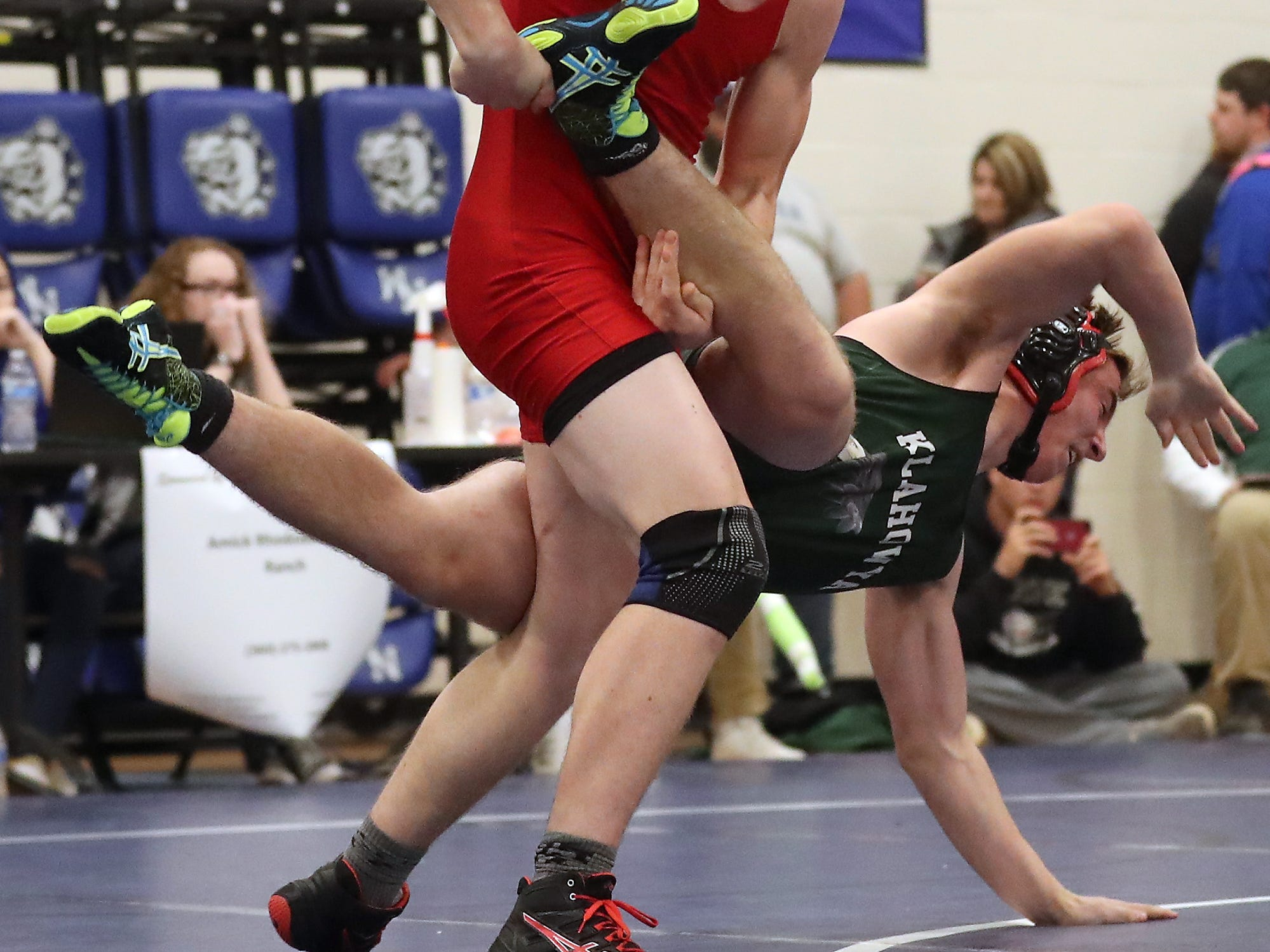 Port Townsend's Dylan Tracer (left) sweeps Klahowya's Hunter Wallis to the mat during their 182-pound finals bout at the North Mason Hawkins Memorial Wrestling Tournament in Belfair on Saturday, December 22, 2018.
