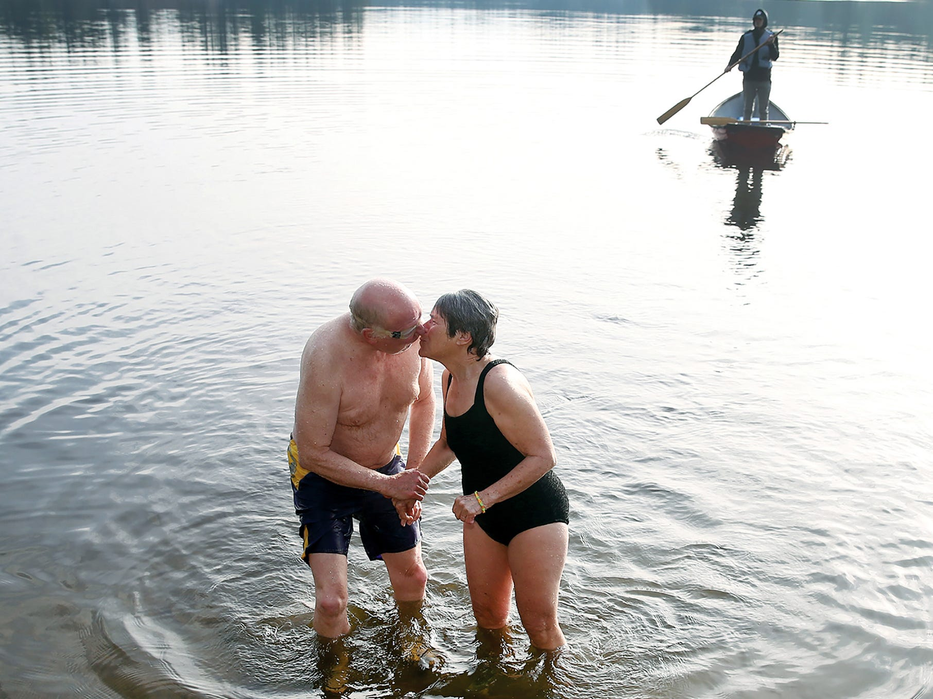Mike Adams of Bremerton give his wife Katherine a kiss after they both did the New Year's plunge into Wildcat Lake on Jan. 1, 2017. Katherine is one of the founders of the event and has down  it for eight years, her husband did his fourth.