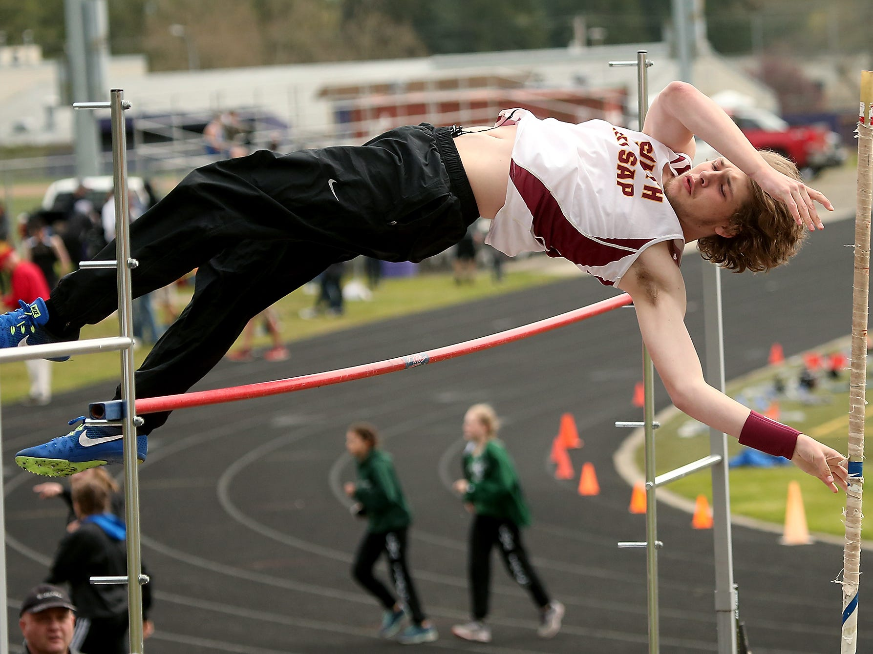 South Kitsap' pole vaulter Brett Wanner soars over the bar during the Lil' Norway Invitational on Saturday, April 21, 2018.