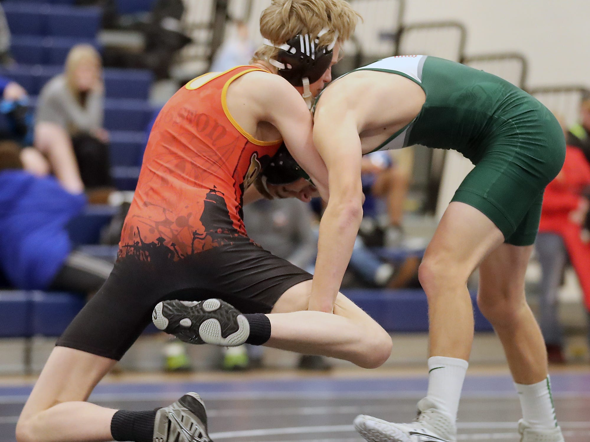 Kingston's Dalton Tellinghuisen (left) grapples with Port Angeles's Daniel Busclen for the final of the 126-pound weight class at the North Mason Classic in Belfair on Saturday, December 22, 2018.