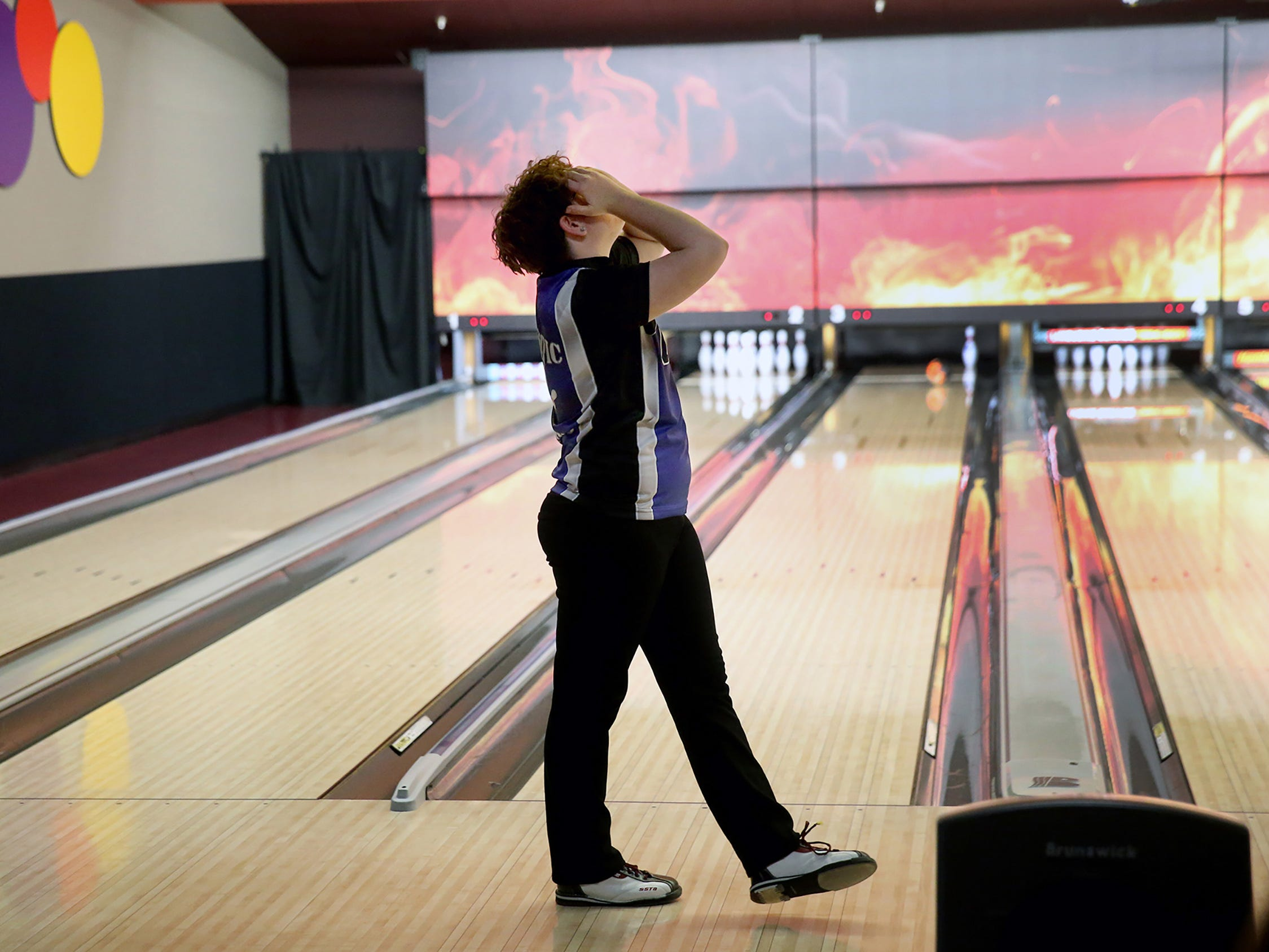 Olympic High School bowler Heather Huskinson reacts to just missing a spare at All-Star Lanes in Silverdale on Thursday, JAN, 11, 2017.